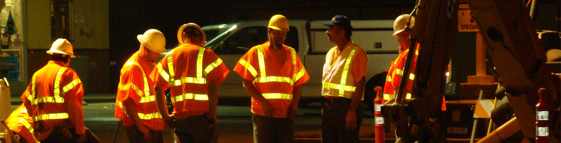 Construction workers at dusk
